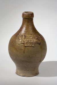 Ale Bottle Attributed to the Sanders Pottery Mortlake, England 1755 Stoneware HOA: 8 5/8 Colonial Williamsburg Foundation, gift in memory of Joseph Porter Moore by his wife, Adelia Peebles Moore Photograph by Craig McDougal